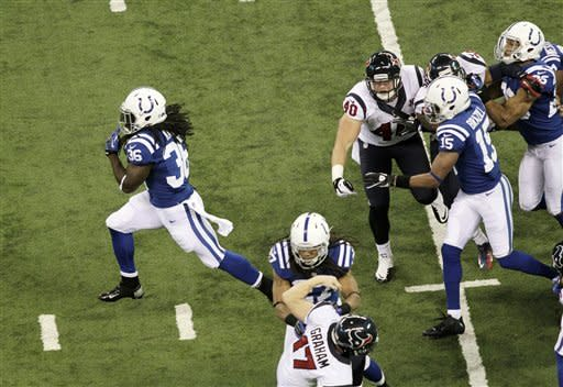Indianapolis Colts' Deji Karim, left, runs back a kickoff 101-yards for a touchdown during the second half of an NFL football game against the Houston Texans Sunday, Dec. 30, 2012, in Indianapolis. (AP Photo/AJ Mast)