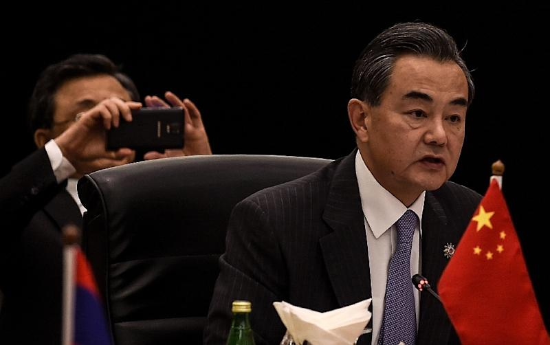 Chinese Foreign minister Wang Yi says Beijing will never give up its claims to South China Sea islands (AFP Photo/Manan Vatsyayana)