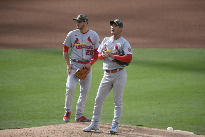 St. Louis Cardinals starting pitcher Kwang Hyun Kim (33) stands on the mound next to third baseman Nolan Arenado (28) before leaving the game in the fourth inning of a baseball game against the San Diego Padres Sunday, May 16, 2021, in San Diego. (AP Photo/Denis Poroy)