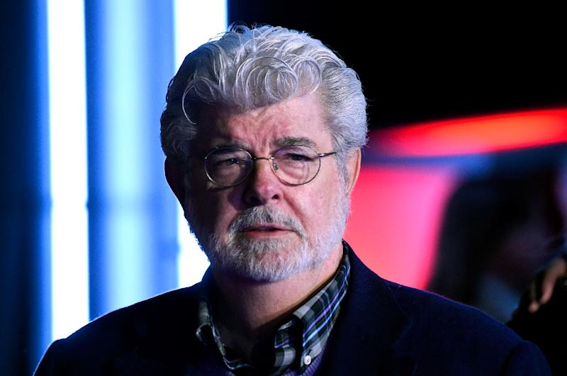 """Filmmaker George Lucas attends the premiere of Walt Disney Pictures and Lucasfilm's """"Star Wars: The Force Awakens"""", in Hollywood, in December 2015 (AFP Photo/Frazer Harrison)"""