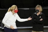 Maryland head coach Brenda Frese and Purdue head coach Sharon Versyp speak prior to the start of an NCAA college basketball game, Sunday, Jan. 10, 2021, in College Park, Md. (AP Photo/Will Newton)