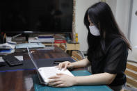 "Han Shin Bi, a high school senior in Seoul, demonstrates how to take online classes after an interview in Seoul, South Korea, on Sept. 18, 2020. ""Online classes were really inconvenient,"" said Han. Experts say the reduced interaction with teachers, digital distractions and technical difficulties are widening the education achievement gap among students in South Korea, leaving those less well off, like Han, at even more at a disadvantage. (AP Photo/Lee Jin-man)"