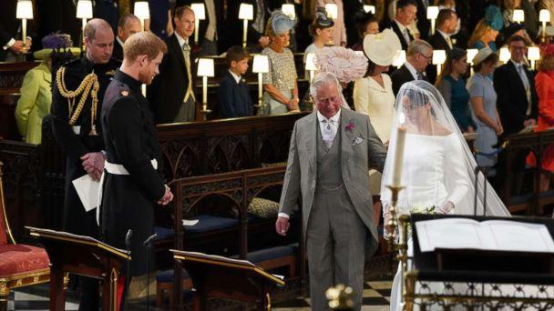 PHOTO: Britain's Prince Harry looks at his bride, Meghan Markle, as she arrives accompanied by the Britain's Prince Charles in St George's Chapel during their wedding ceremony in St George's Chapel, Windsor Castle, in Windsor, May 19, 2018. (Jonathan Brady/AFP/Getty Images)