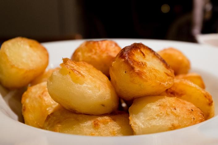 <p>Although some may argue that roasties taste best freshly cooked, if you're pushed for time then you can half roast them the night before.<br><br>According to Mary Berry, all you need to do on the big day is roast them in a hot oven for 20 minutes. It is recommended that you store them in a water-filled container overnight to stop them from browning.<br><br><em>Ingredients:</em><br>1.4kg old potatoes, such as desirée, king edward or maris piper, peeled<br>salt<br>3-4 tbsp goose fat </p>