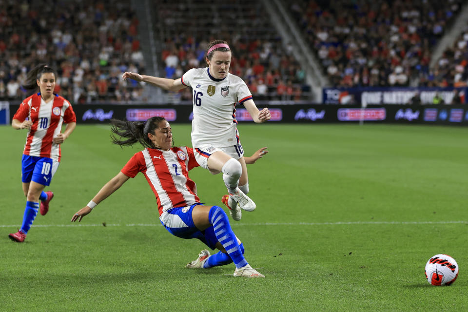 United States midfielder Rose Lavelle (16) leaps over United States defender Abby Dahlkemper (2) as she plays the ball during the first half of an international friendly soccer match, Tuesday, Sept. 21, 2021, in Cincinnati. (AP Photo/Aaron Doster)