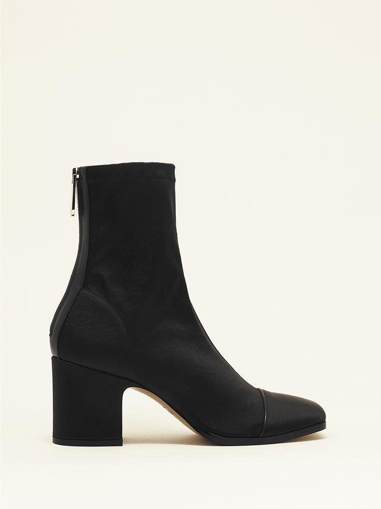"""<br><br><strong>Nomasei</strong> Aria Ankle Boots in Black Stretch Satin, $, available at <a href=""""https://go.skimresources.com/?id=30283X879131&url=https%3A%2F%2Fwww.nomasei.com%2Fen%2Fproduit%2Faria-ankle-boots-in-black-stretch-satin%2F"""" rel=""""nofollow noopener"""" target=""""_blank"""" data-ylk=""""slk:Nomasei"""" class=""""link rapid-noclick-resp"""">Nomasei</a>"""