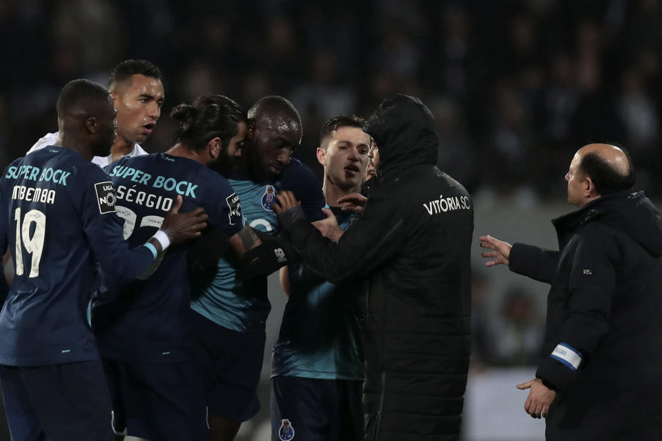 Porto's Moussa Marega, from Mali, fourth left, leaves the pitch during a Portuguese league soccer match between Vitoria SC and FC Porto in Guimaraes, Portugal, Sunday, Feb. 15, 2020. The president and the prime minister of Portugal have added their voices to a national outcry over racist abuse aimed at Moussa Marega who walked off the field after hearing monkey chants. (AP Photo)