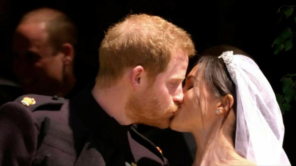 The newlywed share a kiss on the stairs of St George's Chapel at Windsor.