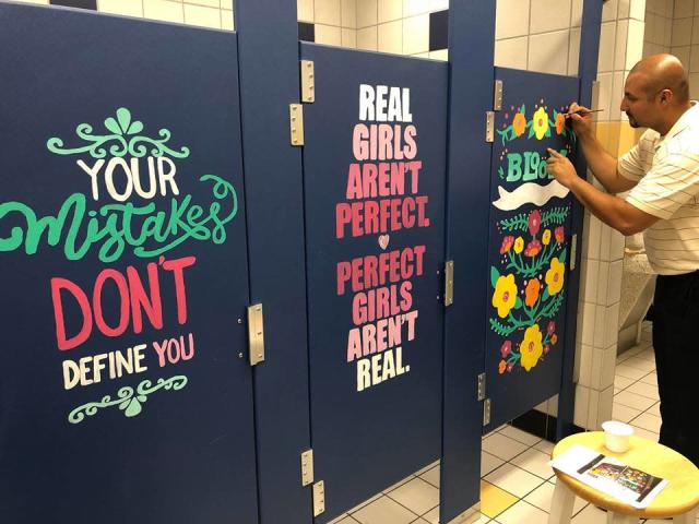 A middle school principal paints motivational murals on bathroom stalls. (Photo: Facebook/Warren.MS.Warriors)