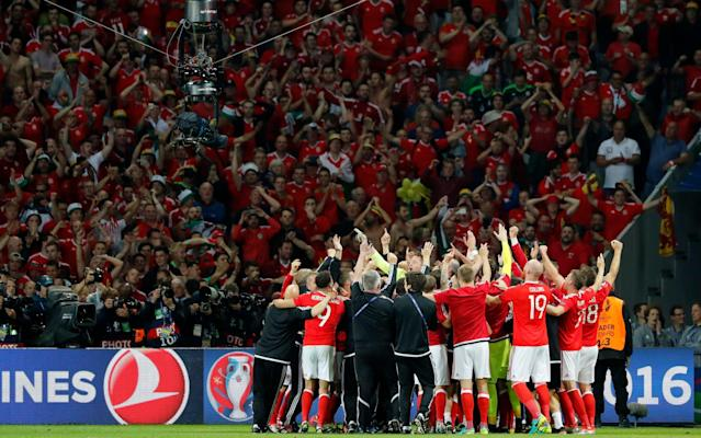 <span>Wales beat Belgium 3-1 to go through to the semi-finals of Euro 2016</span> <span>Credit: EPA/ABEDIN TAHERKENAREH  </span>