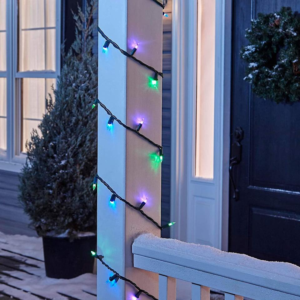 """<p>In the market for quality Christmas lights with colorful bulbs? This dazzling mini LED string comes in a pretty palette of blue, violet, and green and is safe for both indoor and outdoor use.</p> <p><strong><em>Shop Now: </em></strong><em>NOMA Premium Mini LED Christmas Lights, $19.99, <a href=""""https://www.amazon.com/NOMA-Premium-Christmas-Lights-Outdoor/dp/B07X4L727W/ref=as_li_ss_tl?ie=UTF8&linkCode=ll1&tag=mslholourfavoritechristmaslightscbiggsnov20-20&linkId=ca0b28bc9fdd62c993afc6a571b61f07&language=en_US"""" rel=""""nofollow noopener"""" target=""""_blank"""" data-ylk=""""slk:amazon.com"""" class=""""link rapid-noclick-resp"""">amazon.com</a></em><em>.</em></p>"""