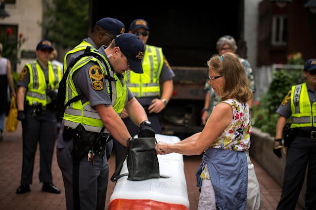 <p>Virginia State Patrol officers check bags at a checkpoint to enter a mall in Charlottesville, Va., on Aug. 11, 2018, in anticipation of the year anniversary of the Unite The Right rally. (Photo: Logan Cyrus/AFP/Getty Images) </p>