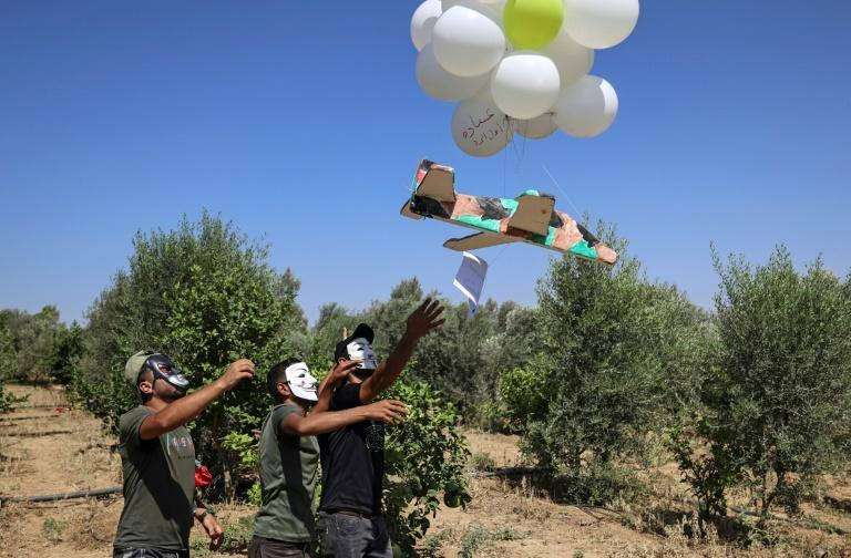 Palestinians regularly release incendiary balloons towards Israel where they start fires in grasslands and on farms (AFP/Mahmud Hams)