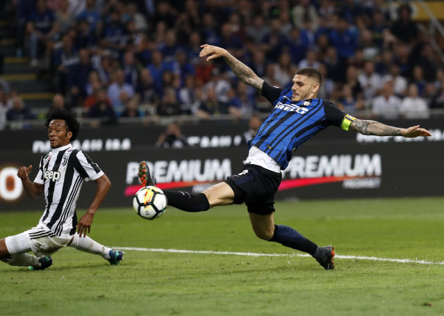 FILE - In this April 28, 2018 file photo, Inter Milan's Mauro Icardi, right, kicks the ball during the Serie A soccer match between Inter Milan and Juventus at the San Siro stadium in Milan, Italy. Mario Goetze, Leroy Sane and Mauro Icardi have each achieved plenty in their careers but they won't be achieving anything at the upcoming World Cup as they belong to a group of elite players left off otheir national team squads. (AP Photo/Antonio Calanni, files)