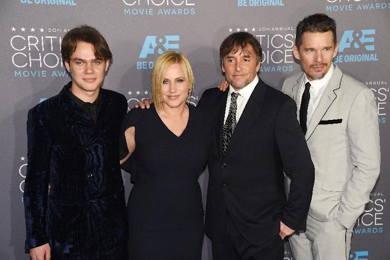 """Boyhood"" actors Ellar Coltrane (L), Patricia Arquette (C) and Ethan Hawke pose with director Richard Linklater at the 20th Annual Critics Choice Awards at the Palladium in Hollywood, California on January 15, 2015 (AFP Photo/Frederic J. Brown)"