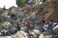 Kevin Mutinda, 7, center, his sister Irene Wanzila, 10, 2nd right, and their mother Florence Mumbua, right, work to break rocks with a hammer, after Mumbua say she was left without a choice after she lost her cleaning job at a private school when coronavirus pandemic restrictions were imposed, at Kayole quarry in Nairobi, Kenya Tuesday, Sept. 29, 2020. The United Nations says the COVID-19 pandemic risks significantly reducing gains made in the fight against child labor, putting millions of children at risk of being forced into exploitative and hazardous jobs, and school closures could exacerbate the problem. (AP Photo/Brian Inganga)