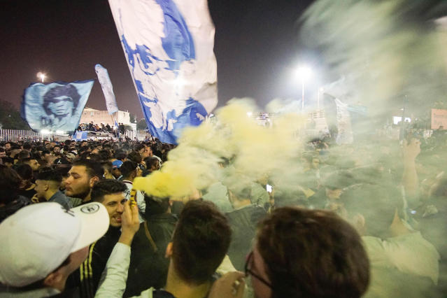 Napoli' supporters wait for Napoli soccer team return from Turin at Capodichino airport, Naples, Italy early Monday April 23, 2018. More than 15,000 fans waited for the team return in the early hours of Monday morning, after the southern-based team won 1-0 in Turin against Juventus to cut the gap to just a solitary point. (Cesare Abbate/ANSA via AP)