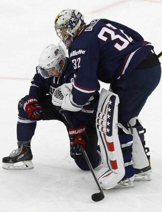 U.S. team Grzelcyk and Gillies react after their loss to Russia in their IIHF Ice Hockey World Championship quarter-final match in Malmo
