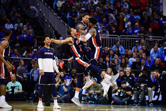 <p>Auburn Tigers players celebrate after scoring against the North Carolina Tar Heels in the third round of the 2019 NCAA Men's Basketball Tournament held at Sprint Center on March 29, 2019 in Kansas City, Missouri. (Photo by Ben Solomon/NCAA Photos via Getty Images) </p>