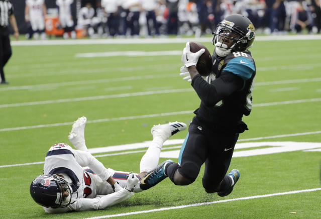 <p>Jacksonville Jaguars wide receiver Allen Hurns (88) is tripped up by Houston Texans cornerback Kevin Johnson (30) after a reception during the second half of an NFL football game, Sunday, Sept. 10, 2017, in Houston. (AP Photo/David J. Phillip) </p>