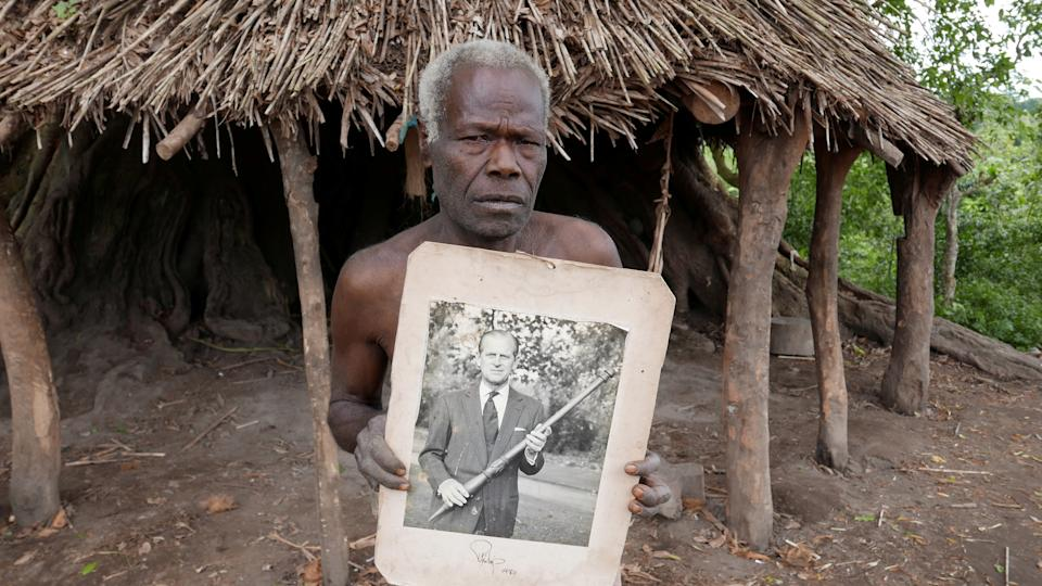 Village elder from Tanna island holds a picture of Britain's Prince Philip where he is worshipped in Younanen, Vanuatu May 6, 2017. Picture taken May 6, 2017. REUTERS/Jill Gralow REFILE - CORRECTING ID