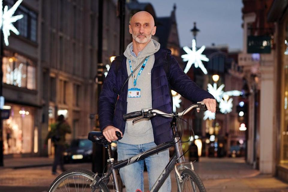 Dr Gary Coleman with his bike during an outreach session (Paul Stuart)
