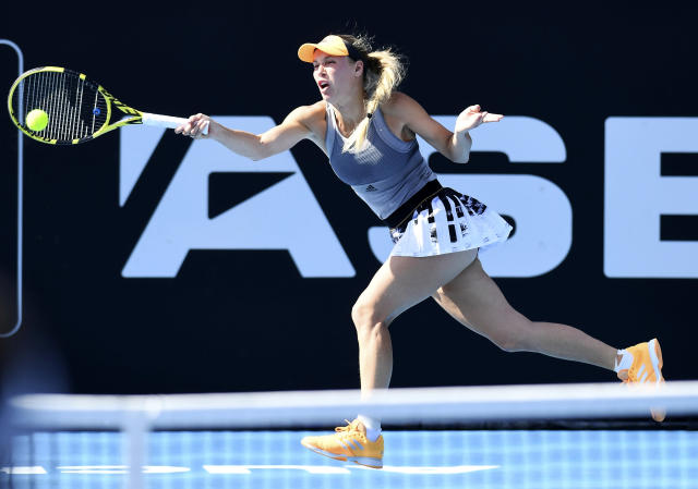 Denmark's Caroline Wozniacki plays a shot during her semifinal singles match against Jessica Pegula of the U.S., at the ASB Classic in Auckland, New Zealand. Saturday Jan. 11, 2020. (Andrew Cornaga/Photosport via AP)
