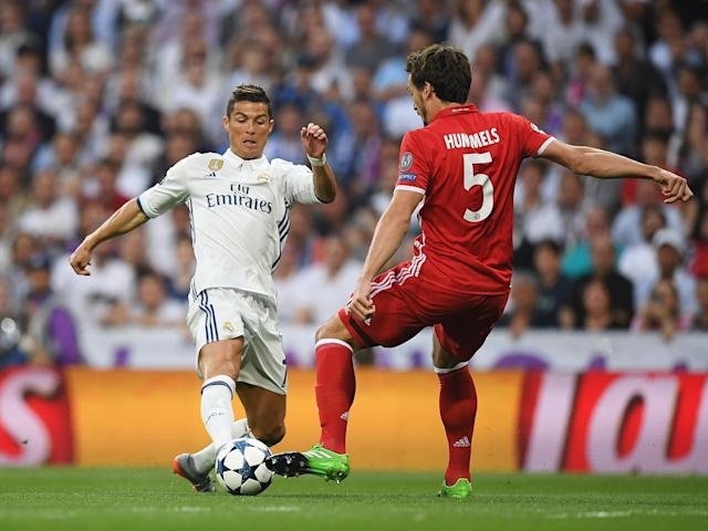 Cristiano Ronaldo and Mats Hummels battle for the ball at the Bernabeu: Getty