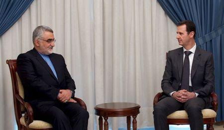 Syria's President Bashar al-Assad meets with Alaeddin Boroujerdi (L), Chairman of Iranian Parliament's National Security and Foreign Policy Commission, in Damascus, in this handout provided by SANA on May 13, 2015. REUTERS/SANA/Handout via Reuters