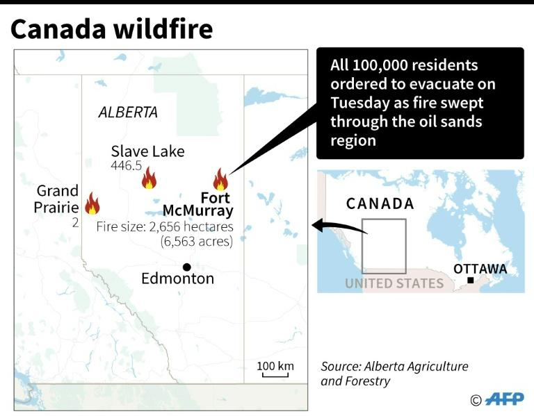 Alberta Agriculture and Forestry Department photo shows smoke rising from a heavily wooded area on May 3, 2016 in the Canadian city of Fort McMurray