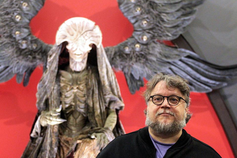 "Guillermo del Toro poses with the monster El Angel de la Muerte from ""Hellboy"" at the ""Guillermo del Toro: At Home With My Monsters"" exhibition in Mexico. (Photo by Ulises Ruiz/AFP via Getty Images)"
