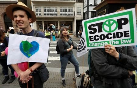 Extinction Rebellion climate activists hold a protest outside the Royal Courts of Justice in London