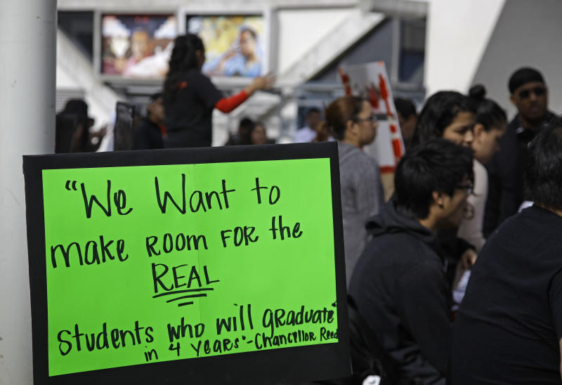 In this photo taken Thursday, Nov. 8, 2012 students rally against higher student fees at San Francisco State University in San Francisco. Deep cuts in state funding have forced California State University to turn away tens of thousands of qualified students because campuses can't accommodate them. After gentler efforts to prod super seniors to graduate, Chancellor Charles Reed wants to start charging them hefty out-of-state tuition once they reach 150 units, a move aimed at making more room for new students. (AP Photo/Eric Risberg)