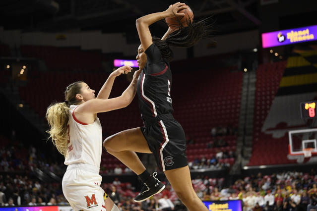South Carolina forward Victaria Saxton, right, drives to the basket as Maryland forward Faith Masonius, left, defends during the first half of an NCAA college basketball game, Sunday, Nov. 10, 2019, in College Park, Md. (AP Photo/Nick Wass)