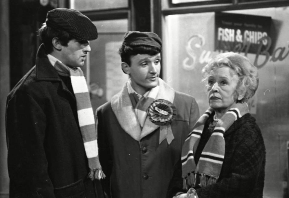 John Challis, in 1967, the first of several Coronation Street appearances, on this occasion playing George Naylor, left, with Bill Lyons as Lenny Johnson and Doris Speed as Annie Walker - ITV/Shutterstock