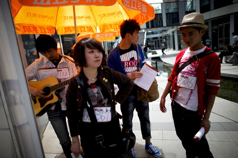 "In this Tuesday, May 10, 2011 photo, Chinese contestants wait to take part an audition for the ""X Factor"" television talent show in Beijing, China. Chinese authorities are cracking down on how often broadcasters can air reality, dating and talent shows such as the Chinese versions of ""American Idol"" and ""The Voice,"" which draw huge audiences. (AP Photo/Andy Wong)"