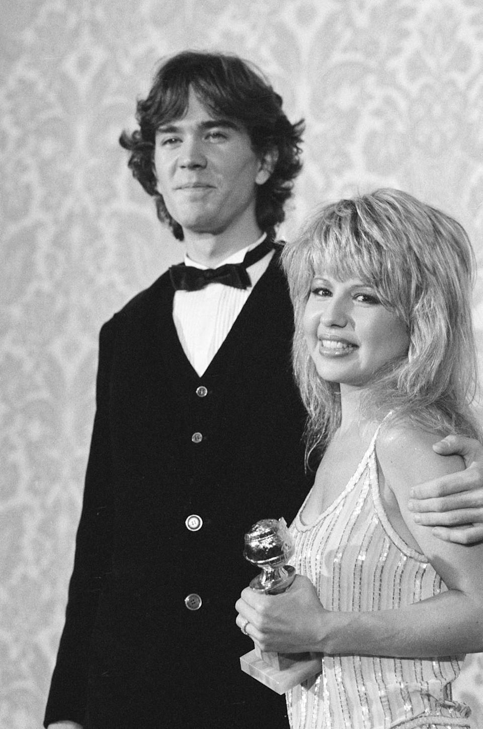 Pia Zadora holds a Golden Globes statuette in a picture with her husband