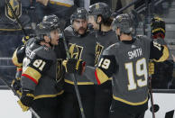 Vegas Golden Knights celebrate after Alex Tuch, center, scored against the Arizona Coyotes during the second period of an NHL hockey game Friday, Nov. 29, 2019, in Las Vegas. (AP Photo/John Locher)