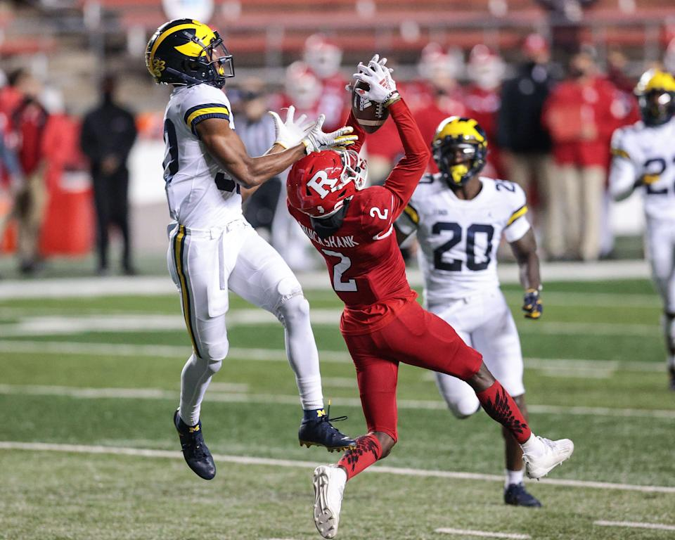 Rutgers Scarlet Knights wide receiver Aron Cruickshank (2) catches the ball against Michigan Wolverines defensive back Daxton Hill (30) during the first half at SHI Stadium.
