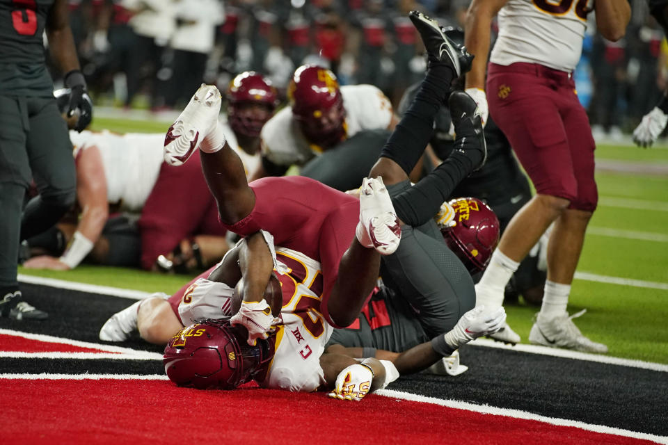 Iowa State running back Breece Hall (28) scores a touchdown against UNLV during the first half of an NCAA college football game Saturday, Sept. 18, 2021, in Las Vegas. (AP Photo/John Locher)