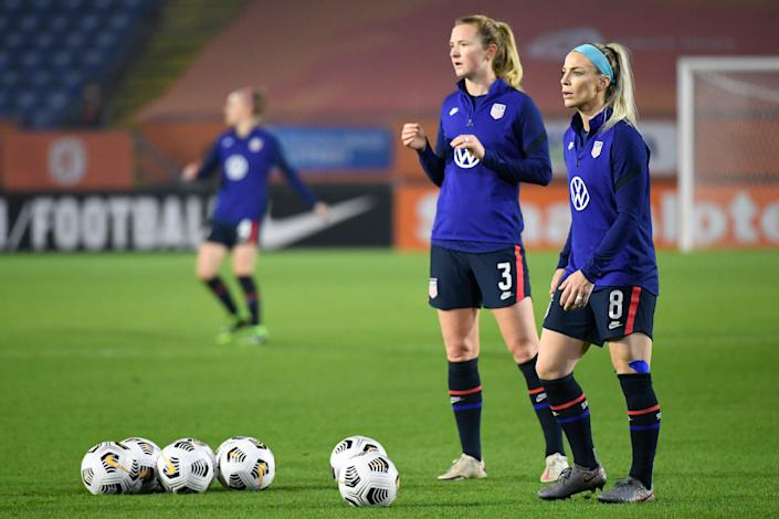 United States' Julie Ertz, right, and United States' Samantha Mewis warm up prior to the international friendly women's soccer match between The Netherlands and the US at the Rat Verlegh stadium in Breda, southern Netherlands, Friday Nov. 27, 2020. (Piroschka van de Wouw/Pool via AP)