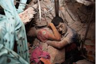 <p>2013. Two victims of a garment factory building collapse in Savar, Bangladesh.</p>