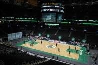 The Boston Celtics and the Milwaukee Bucks warm up before an NBA basketball game Wednesday, Dec. 23, 2020, in Boston. (AP Photo/Michael Dwyer)