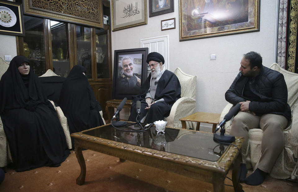 In this picture released by the official website of the office of the Iranian supreme leader, Supreme Leader Ayatollah Ali Khamenei, center, meets family of Iranian Revolutionary Guard Gen. Qassem Soleimani, who was killed in the U.S. airstrike in Iraq, at his home in Tehran, Iran, Friday, Jan. 3, 2020. (Office of the Iranian Supreme Leader via AP)