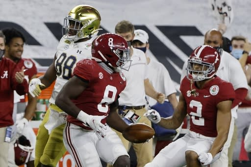 Alabama linebacker Christian Harris (8) and defensive back Patrick Surtain II (2) celebrate a interception by Harris on a pass intended for Notre Dame wide receiver Javon McKinley (88) in the second half of the Rose Bowl NCAA college football game in Arlington, Texas, Friday, Jan. 1, 2021. (AP Photo/Michael Ainsworth)