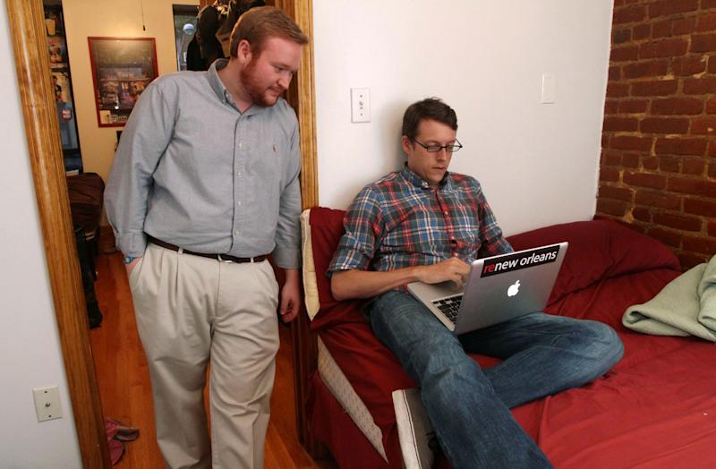 Mathew Sanders, left, and Mark Bonner pose for a photograph Wednesday Aug. 24, 2011 in the two bedroom apartment they share in New York.   Census figures show that Manhattan had a dip in single-person households this past decade, despite being the capital of single living. (AP Photo/Tina Fineberg)