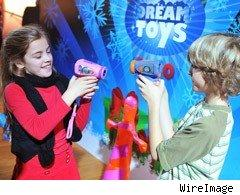 Children play with one of this Christmas' hottest toys - the Kidizoom VideoCam