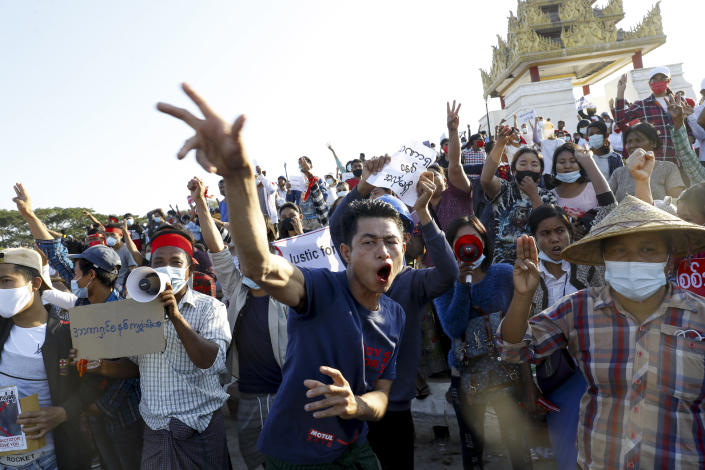 FILE - In this Feb. 10, 2021, file photo, demonstrators flash a three-fingered symbol of resistance against the military coup and shout slogans calling for the release of detained Myanmar leader Aung San Suu Kyi during a protest in Mandalay, Myanmar. When army generals in Myanmar staged a coup last week, they briefly cut internet access in an apparent attempt to stymie protests. Around the world, shutting down the internet has become an increasingly popular tactic by repressive and authoritarian regimes and some illiberal democracies. (AP Photo, File)