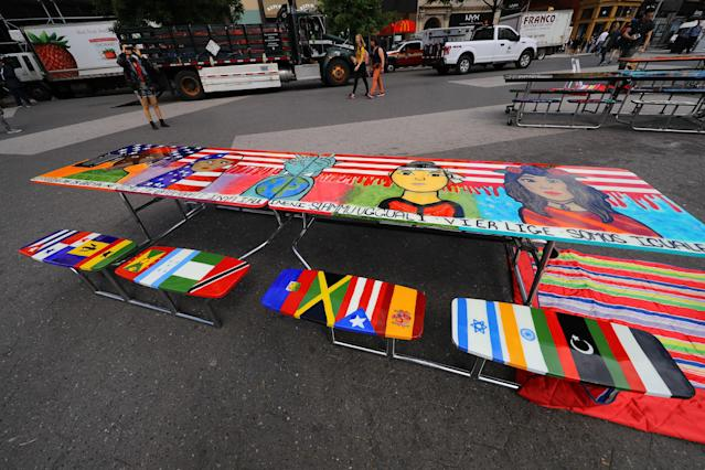 "<p>The table on the theme of ""Immigration: We are all equal"" created by students on display in Union Square Park in New York City on June 5, 2018. (Photo: Gordon Donovan/Yahoo News) </p>"