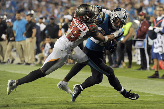Tampa Bay Buccaneers cornerback Vernon III Hargreaves (28) tackles Carolina Panthers running back Christian McCaffrey late in the second half of an NFL football game in Charlotte, N.C., Friday, Sept. 13, 2019. Tampa Bay won 20-14. (AP Photo/Mike McCarn)